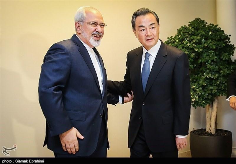 ایران و چین بر حل بحران سوریه تأکید کردند